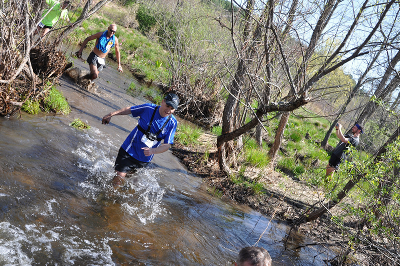 Rob Cummings and Micah True (aka Caballo Blanco) run through Splashdown - the final water crossing in the Leatherman's Loop 2011.