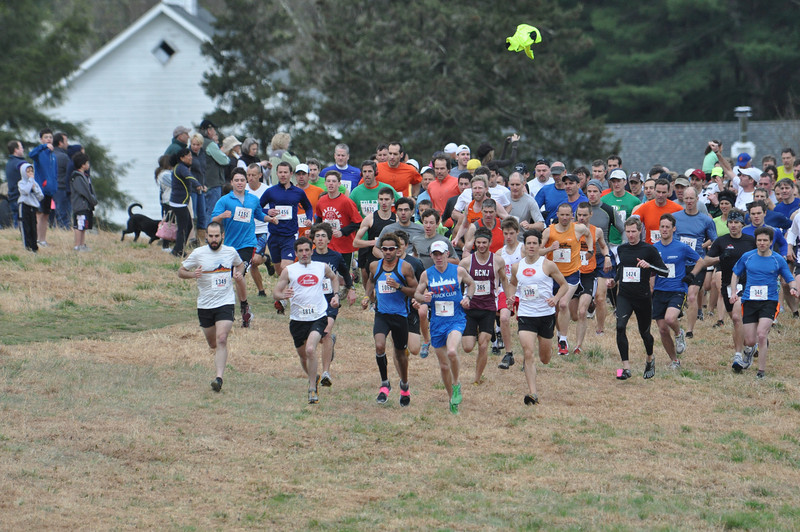Leading the pack at the 2012 Leatherman's Loop start: Top 3 finshers: Winner Matthew Byrne (bib #1814), 3rd place Roberto Mandje (bib #1066), and seven time Loop winner Tommy Nohilly (bib #1) who finished second overall. Fourth place finisher Matt Rosetti (#1396) and fifth place overall finisher Andrew Capizzi (#365) were close on their heels the whole way. John Jay varisty runner Matt Kershner is just behind Matthew Byrne in this photo and finished 37th overall, just behind rival Benjamin Barton of Fox Lane (in this photo behind Matt Rosetti and Andrew Capizzi) who finished 13th overall and first for the under 19 division.
