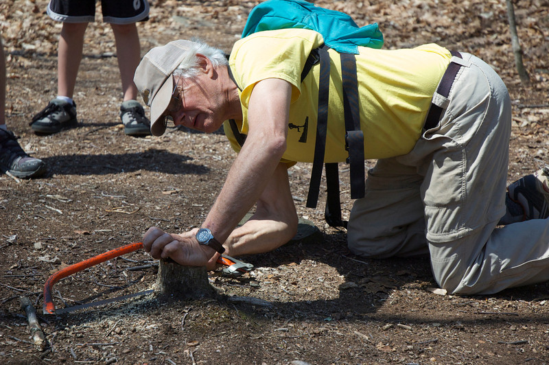 Tony clearing obstacles from the trail for the runners.