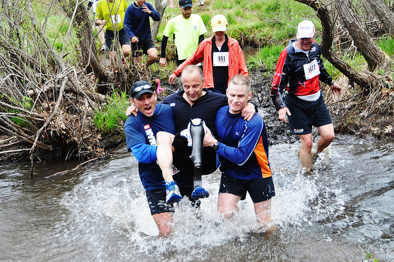 Ray Viscome crosses Splashdown with help from friends Rich Izzo and Tom Bookless. Photo by Michelle Blum.