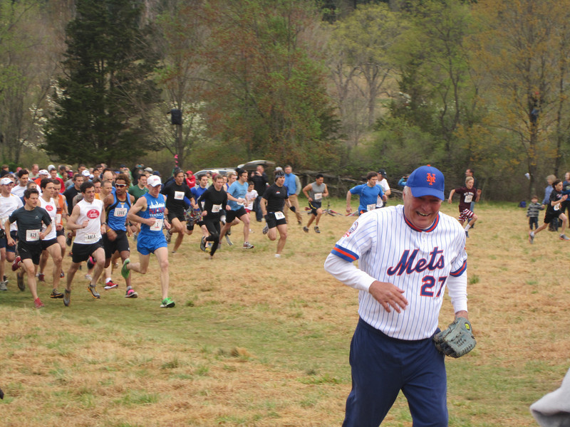 Former Mets ace and official Loop starter Craig Swan gets out of the way as runners get the start signal from his first pitch. Photo by Brian Lynch.